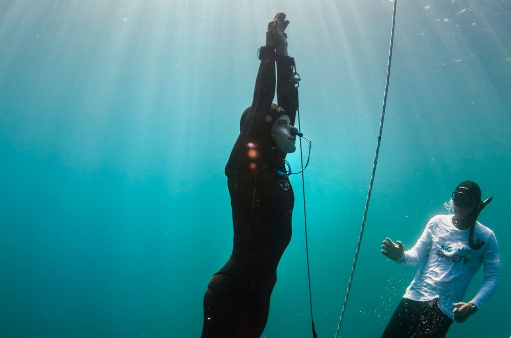 Sofia Gomez Uribe surfaces from a successful 75 meter freedive in Constant Weight with Fins at the Big Blue Freediving competition on November 3, 2015 off the coast of La Paz, Mexico. The freedive down and back was made on breath-hold, and set both a National Record and Continental Record. Gomez Uribe is a 13-time national record holder for Mexico. Photo by Logan Mock-Bunting ONE-TIME USE ONLY. NOT FOR ARCHIVE. NOT FOR REDISTRIBUTION